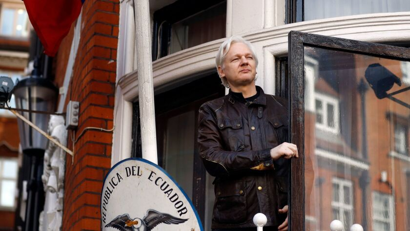FILE- In this Friday May 19, 2017 file photo, WikiLeaks founder Julian Assange greets supporters out