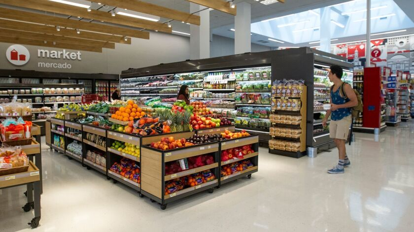 A student walks by the produce section at the newly opened Target small-format store in Irvine on We