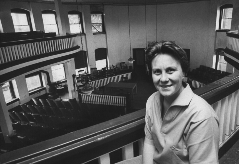 "Author of ""To Kill a Mockingbird,"" Harper Lee, in a local courthouse while visiting her hometown."