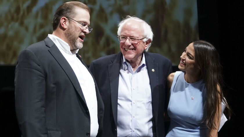 Sen. Bernie Sanders and Alexandria Ocasio-Cortez appear at a campaign rally in Wichita for Kansas congressional candidate James Thompson, left, on July 20.