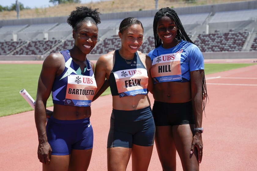 Americans Tianna Bartoletta, Allyson Felix and Candace Hill celebrate after winning the women's 3x100-meter relay.