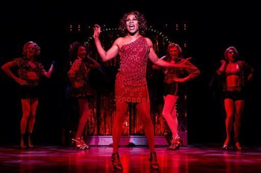 """This theater image released by The O+M Company shows Billy Porter during a performance of """"Kinky Boots."""" The Cyndi Lauper-scored """"Kinky Boots"""" has earned a leading 13 Tony Award nominations, Tuesday, April 30, 2013. """"Kinky Boots"""" is based on the 2005 British movie about a real-life shoe factory tha"""
