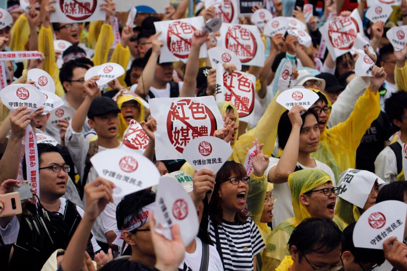 Demonstrators in Taiwan rally against pro-China media. A global study found that the island was the territory most exposed to foreign disinformation.