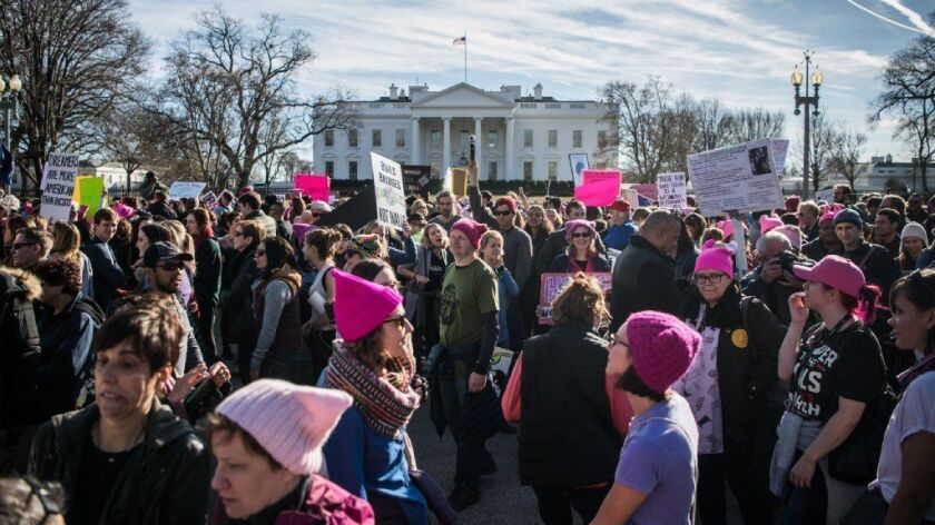 Attendees gather in front of the White House during the Women's March in Washington on Jan. 20, 2018.