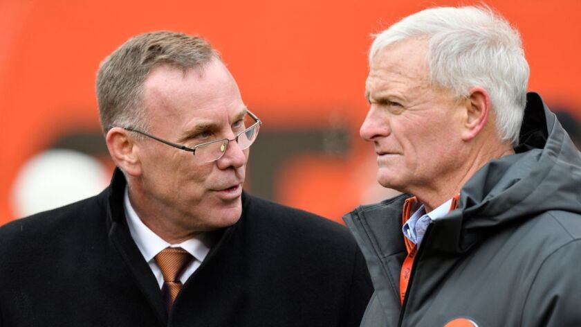 Cleveland Browns general manager John Dorsey, left, talks with owner Jimmy Haslam before a game against the Green Bay Packers in Cleveland on Sunday.