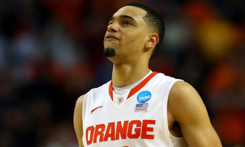 Syracuse's Tyler Ennis reacts after missing a shot in the closing seconds of his team's 55-53 loss to Dayton in the third round of the NCAA tournament. He is one of several top NBA prospects whose teams failed to advance to the Sweet 16.