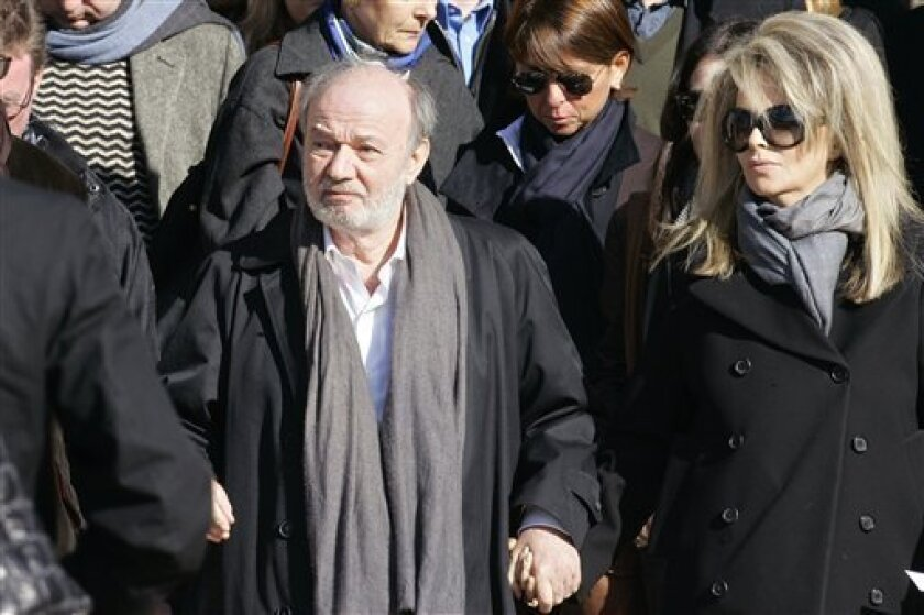 Oct. 17 2008 file picture shows French director and producer Claude Berri, left, and his companion French writer  Nathalie Rheims, right, leaving  the church after the funeral ceremony for Guillaume Depardieu in Bougival, west of Paris. French actor, director and producer Claude Berri has been hos
