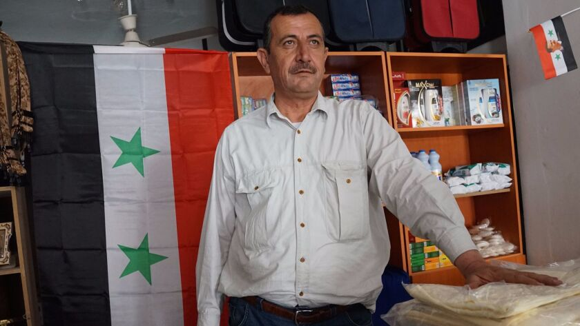 Isa Al Khateeb 50, a lonely resident returned to the town of Palmyra at his newly reopened shop