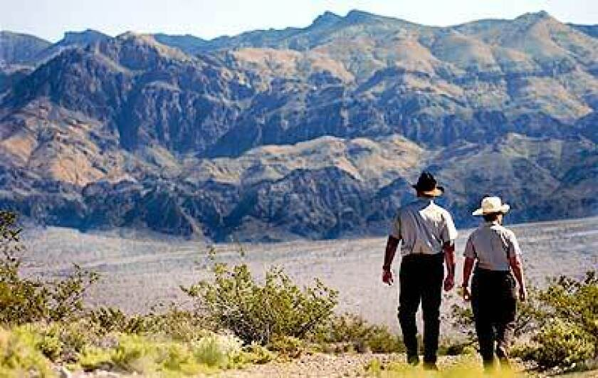Dick Birger and Amy Sprunger walk in Nevada's Desert National Wildlife Refuge.