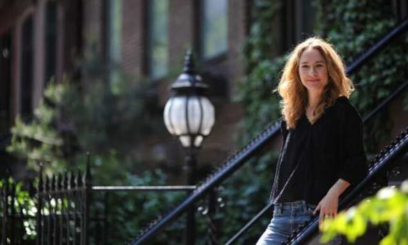 """Playwright Julie Marie Myatt is seen outside the New Dramatists Building in Manhattan. She is working on a play for community-based Cornerstone Theater Company called """"Someday,"""" about abortion rights."""