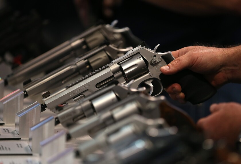 Smith and Wesson handguns are displayed during the 2015 NRA Annual Meeting & Exhibits on April 10 in Nashville.