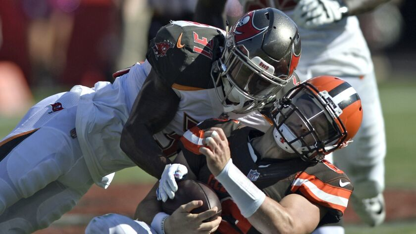 Tampa Bay Buccaneers defensive back Jordan Whitehead (31) hits Cleveland Browns quarterback Baker Ma
