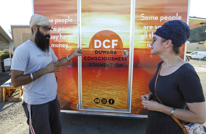 Harisimran Khalsa (right) and her husband Davinder Singh are co-founders of the Duwara Consciousness Federation,