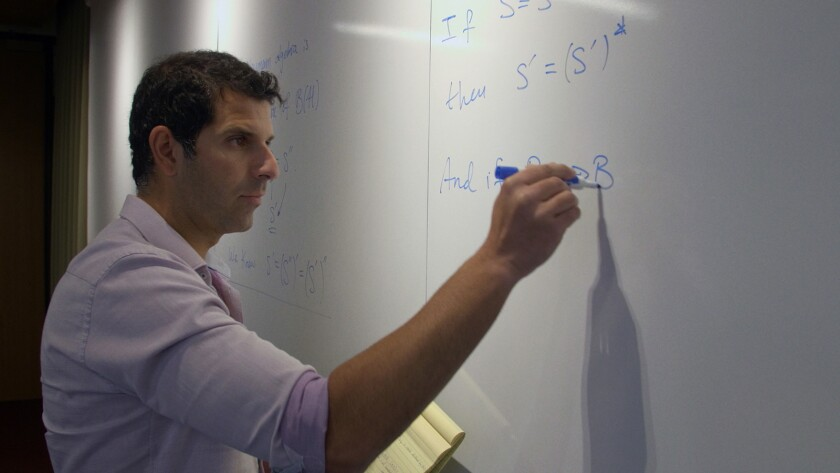 """California Institute of Technology physicist Spiros Michalaki in a scene from """"Trust Machine: The St"""