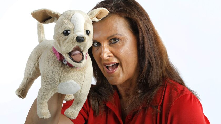 Tracie Arlington is the founder of Play It Safe Defense Inc., which teaches self-defense focused on educating women and children. She is pictured here with the company mascot, C.C. the Chihuahua, which is used to teach kids to be confident and defend themselves.