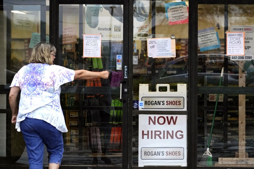 FILE - In this Thursday, June 24, 2021 file photo, A hiring sign is displayed outside a retail store in Buffalo Grove, Ill. Even in a July jobs report that was nearly universally hailed as a good one, pockets of weakness and concern are still clouding the celebration, Friday, Aug. 6, 2021. (AP Photo/Nam Y. Huh, File)