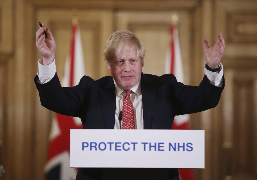 British Prime Minister Boris Johnson speaks during a coronavirus press briefing to announce new measures to limit the spread of the virus, at Downing Street in London on March 22.
