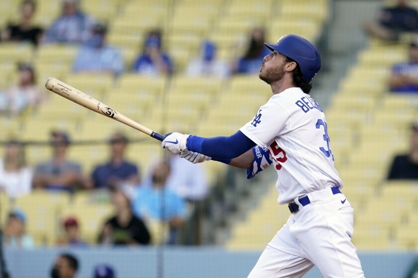 Los Angeles Dodgers' Cody Bellinger follows through on his grand slam during the first inning of a baseball game against the St. Louis Cardinals Wednesday, June 2, 2021, in Los Angeles. (AP Photo/Marcio Jose Sanchez)