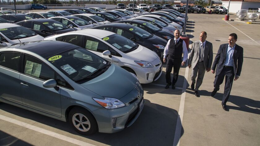 Roger Hogan, left, and sons Roger Hogan and Stephen Hogan at their family dealership Toyota of Claremont. The Hogans refused to sell these Prius vehicles, believing they were not safe to drive because the power system has a defect.