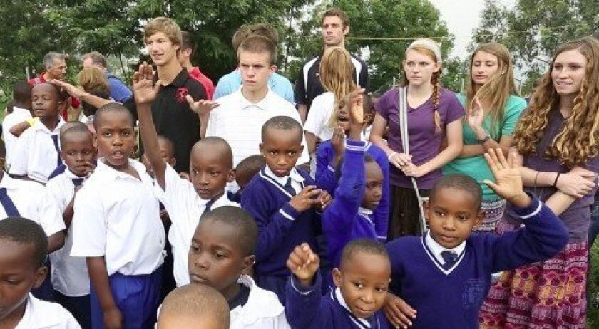 Students from Kigala Christian School in Rwanda, front, and Santa Fe Christian School, back. In the middle is Andrew Appleby, white shirt, and at the far right is Katie North.