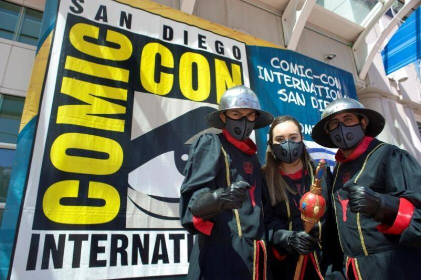 Three people dressed as characters from the series, Pennyworth, pose for pictures outside the San Diego Convention Center on the first day of the San Diego Comic Con International 2019 (SDCC) in San Diego, California, USA, 18 July 2019. EFE/EPA/David Maung