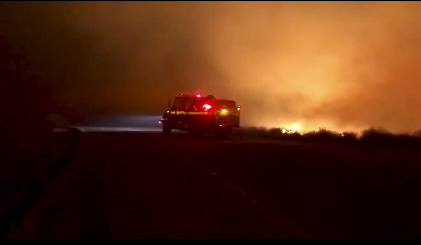 Firefighters are trying to knock down a North County fire stoked by Santa Ana winds