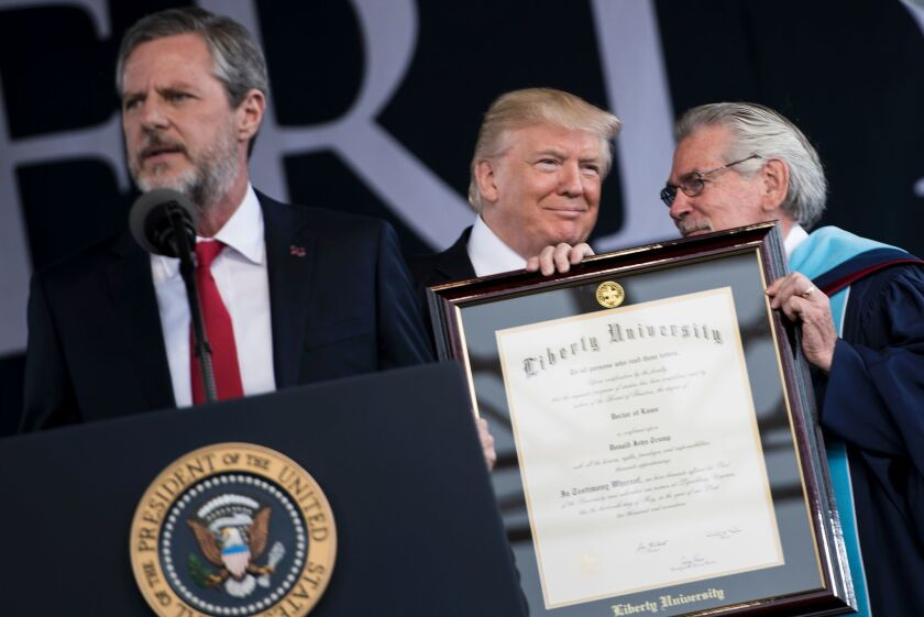 President of Liberty University Jerry Falwell speaks while President Donald Trump is presented with an honorary doctorate during Liberty University's commencement ceremony in Lynchburg, Virginia on May 13, 2017.