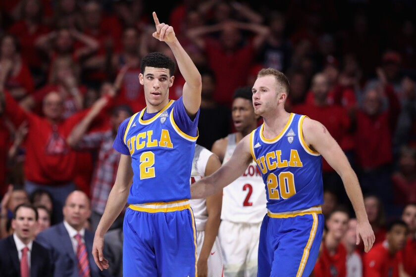 Bruins guards Lonzo Ball (2) and Bryce Alford (20) celebrate after forcing a turnover during the second half against Arizona on Saturday.