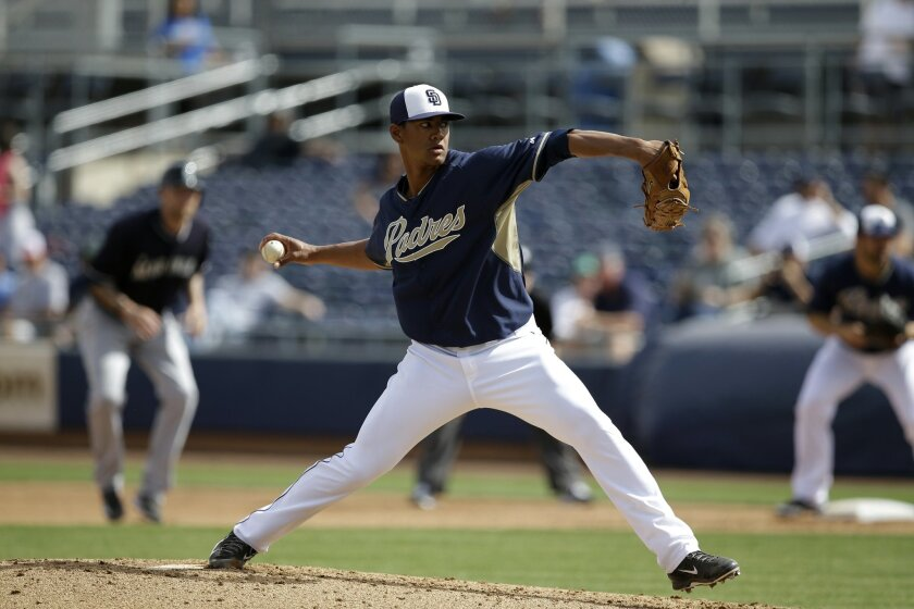 San Diego Padres' Joe Ross delivers to the Seattle Mariners during an exhibition baseball game, Friday Feb. 28, 2014, in Peoria, Ariz. (AP Photo/Tony Gutierrez)