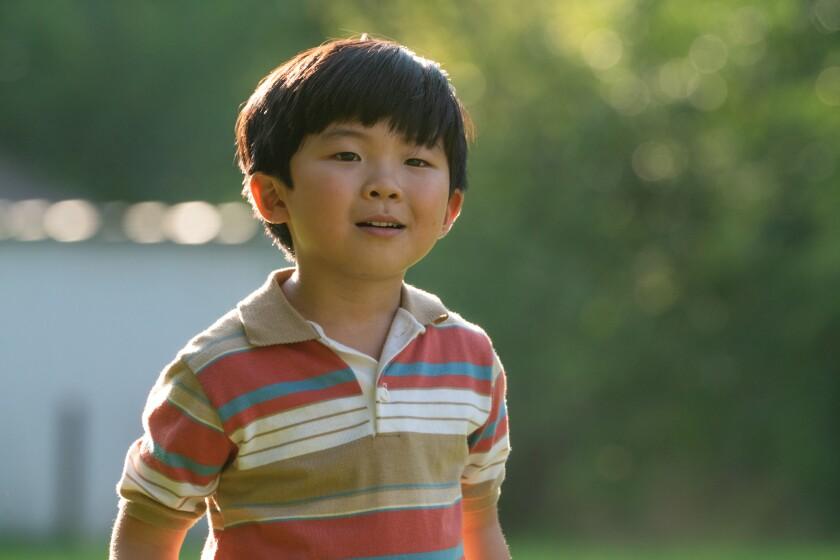 """Alan S. Kim en una escena de """"Minari""""."""