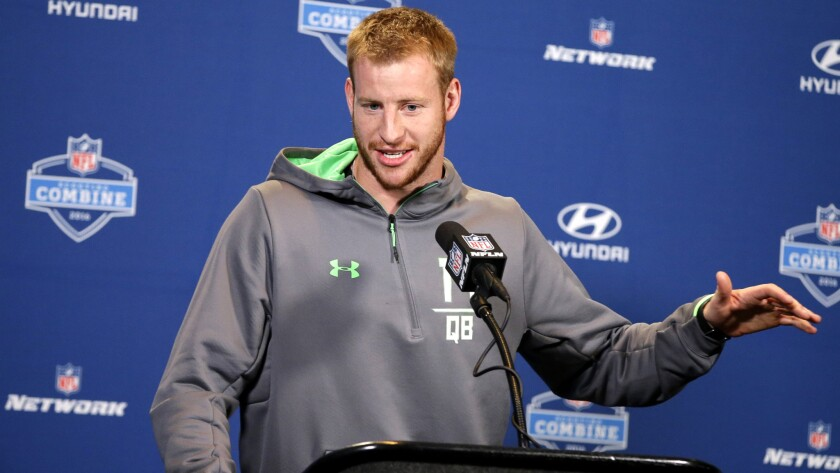 Carson Wentz answers a question during a news conference at the NFL combine on Feb. 25.