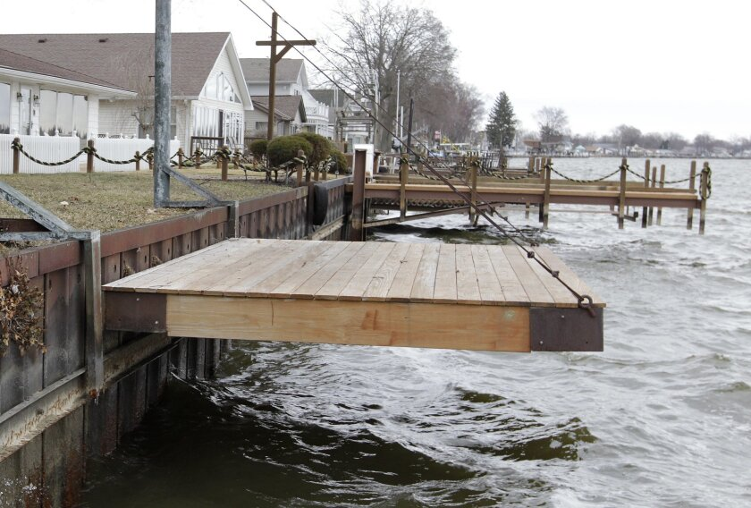 FILE - This March 23, 2015, file photo shows newer docks along the 4.1-mile earthen dam at Buckeye Lake in Buckeye Lake, Ohio. Water levels have been kept low at the Central Ohio lake because of the deteriorated dam, which is nearly 180 years old, but state officials said Thursday, May 26, 2016, th