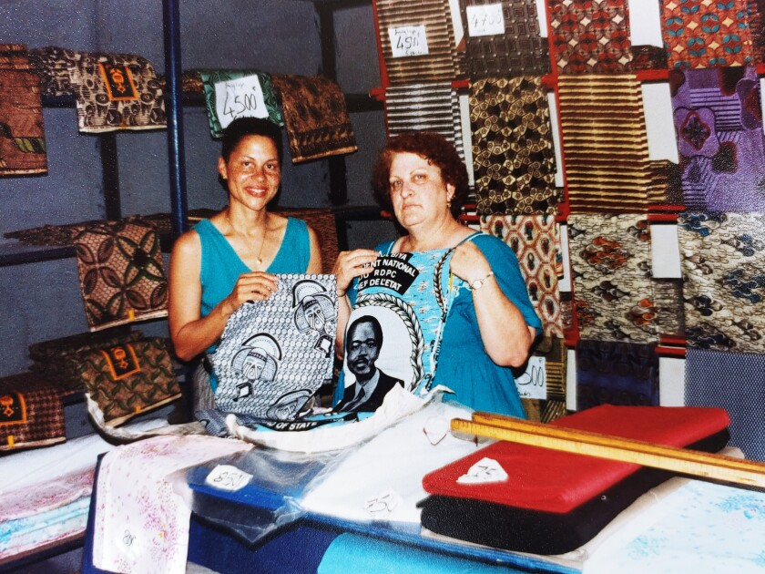 San Diegan Michelle Powell (left) with her birth mother, Cindi, during a trip to Cameroon 25 years ago.