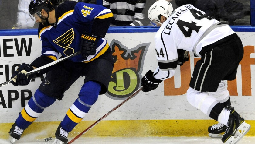 Kings center Vincent Lecavalier (44) battles Blues defenseman Robert Bortuzzo for possession of the puck during the first period Thursday night in St. Louis.