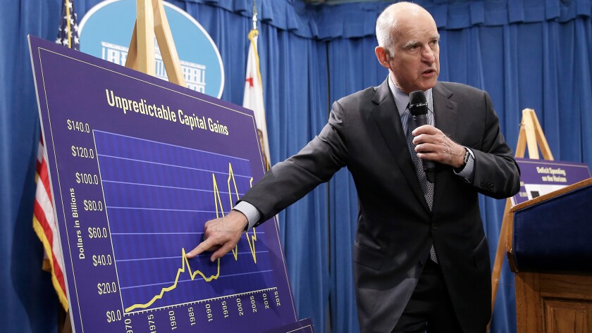 Gov. Jerry Brown points out swings in capital gains revenue during his revised 2016-17 budget presentation in May.