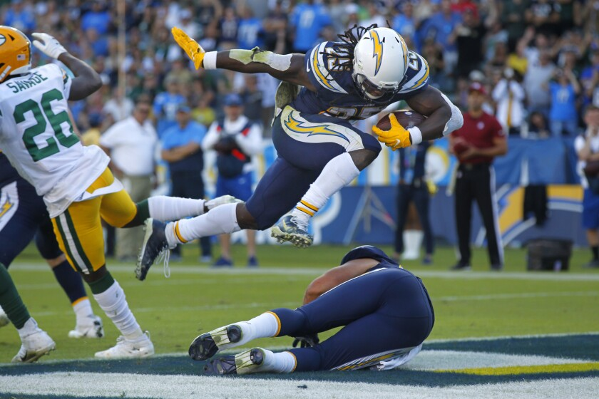 Los Angeles Chargers running back Melvin Gordon leaps into the end zone for a touchdown during the first half of Sunday's game in Carson.