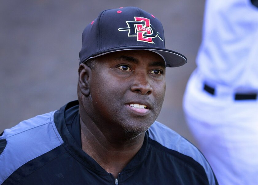 Tony Gwynn talks with fans while coaching at San Diego State.