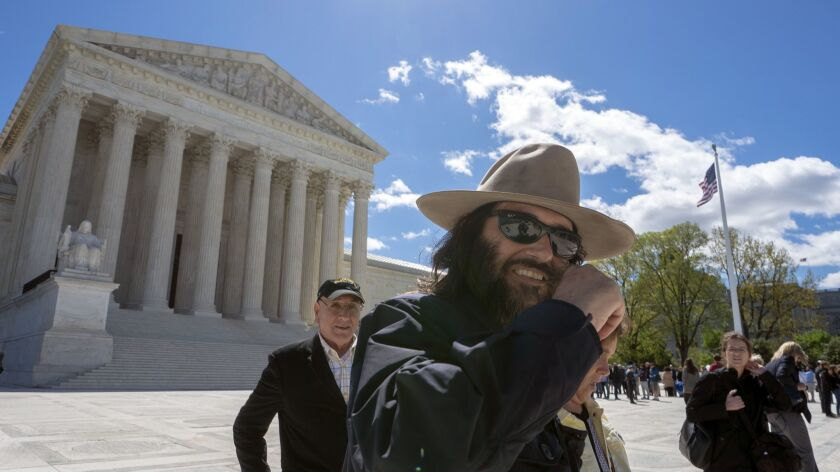 "Los Angeles artist Erik Brunetti, the founder of the streetwear clothing company ""FUCT,"" leaves the Supreme Court after his trademark case was argued, in Washington on April 15."