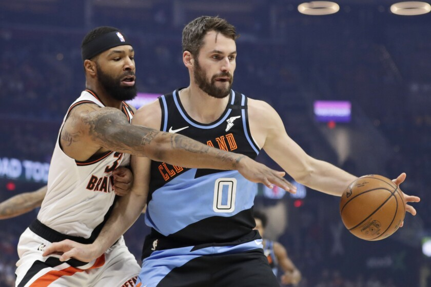 Clippers forward Marcus Morris Sr. tries to steal a pass to Cavaliers forward Kevin Love.