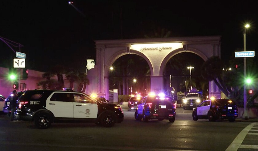 Police converge on the Paramount Pictures lot in Hollywood on Sunday night.