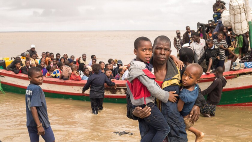 In this photo supplied by the Red Cross Red Crescent Climate Centre survivors of Cyclone Idai arrive