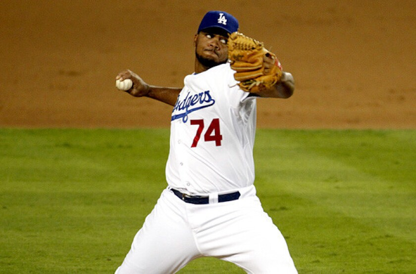 Dodgers closer Kenley Jansen had a 4-3 record last season with 28 saves and 1.88 earned-run average. Above, Jansen pitches in the ninth inning against the St. Louis Cardinals in game 3 of the NLCS, which the Dodgers won 3-0.