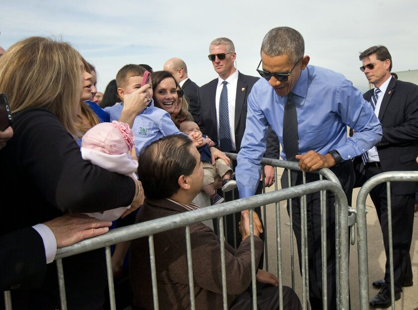 President Barack Obama greets guests on the tarmac by before boarding Air Force One at Moffett Federal Airfield in Mountain View, Calif., Thursday, Feb. 11, 2016. Obama is traveling Los Angeles to tape an appearance on the Ellen DeGeneres Show and attend a pair of private Democratice fundraisers la