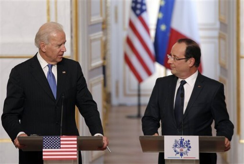 U.S. Vice President Joe Biden, left, and French President Francois Hollande attend a press conference after their talks, in Paris, Monday, Feb. 4, 2013. (AP Photo/Christophe Ena)