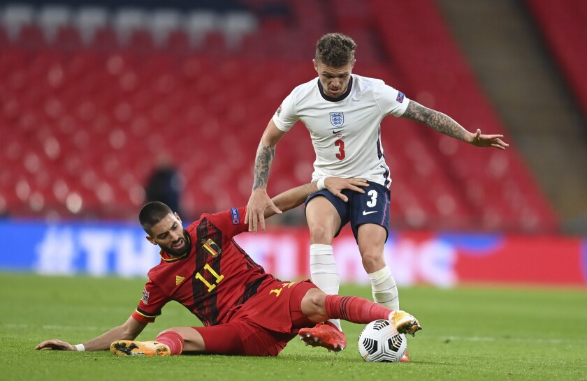 England's Kieran Trippier, right, is challenged by Belgium's Yannick Carrasco during the UEFA Nations League soccer match between England and Belgium at Wembley stadium in London, Sunday, Oct. 11, 2020. (Michael Regan/Pool via AP)