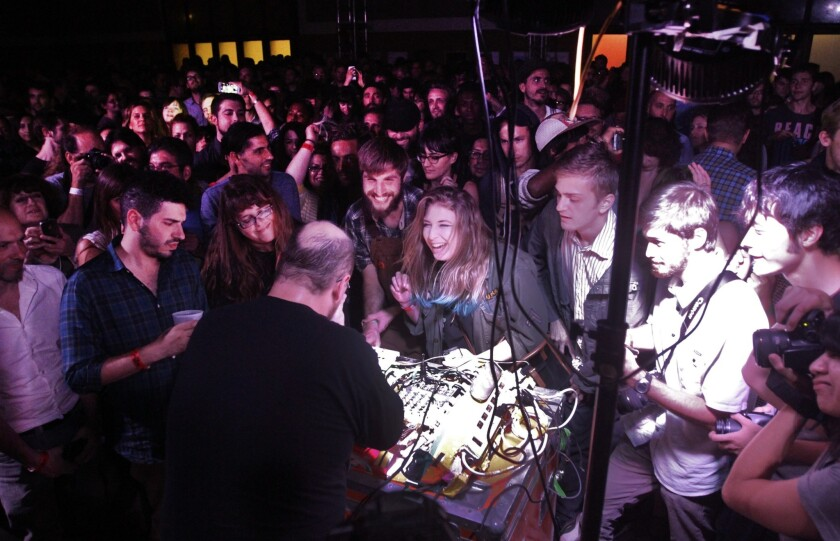 "In 2013, The Times documented part of the ""Station to Station"" art show. Here, DJ Dan Deacon performs at the ""Station to Station"" downtown L.A. event."