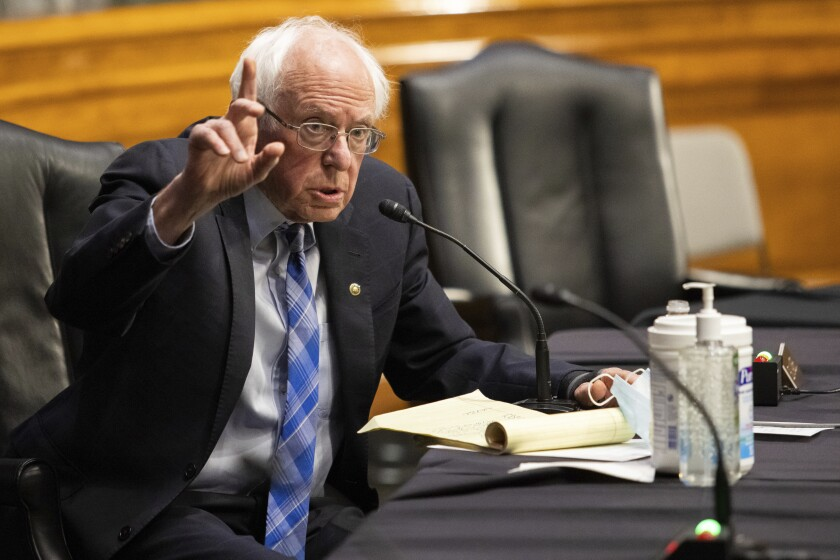 Sen. Bernie Sanders (I-Vt.) sitting at a table.