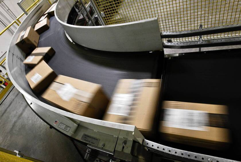 States said they lose more than $23 billion a year in revenue when shoppers buy products online and fail to pay the required sales tax. Above, packages ready to ship move along a conveyor belt at the Amazon.com fulfillment center in Phoenix last year.
