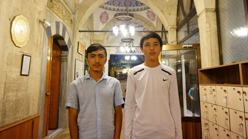 Adil Ahmad, right, 15, from Yarakan, says his parents are in a reeducation camp, and four of his siblings in China are missing, presumed in some kind of detention. Nuruddin, left, 16, says his parents are in a camp near their home in Urumchi.