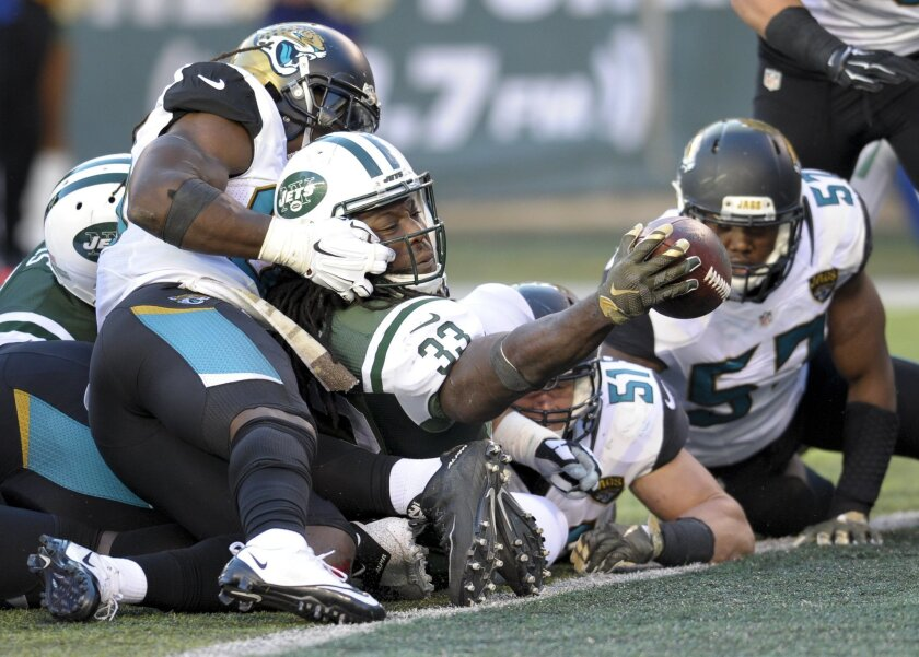New York Jets running back Chris Ivory (33) reaches the ball across the goal line for a  touchdown against the Jacksonville Jaguars during the third quarter of an NFL football game, Sunday, Nov. 8, 2015, in East Rutherford, N.J. (AP Photo/Bill Kostroun)